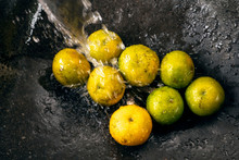 Tangerines Are Washed In The Stone Sink