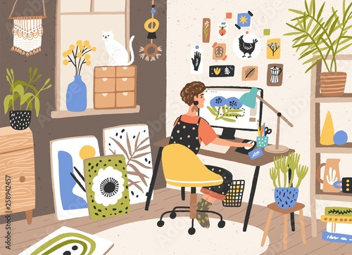 Photographie Female graphic designer, illustrator or freelance worker sitting at desk and work on computer at home