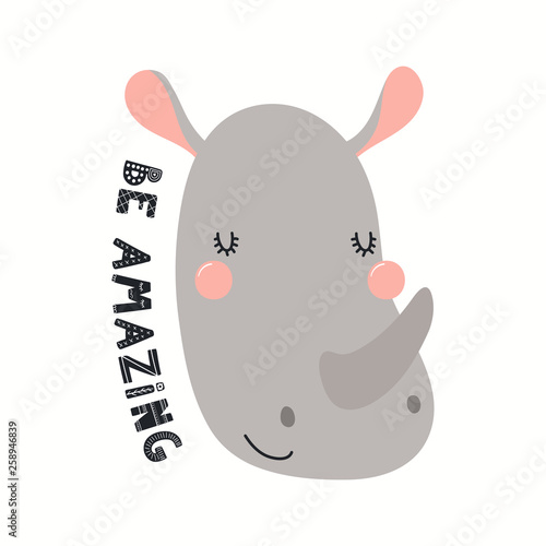 Hand drawn vector illustration of a cute funny rhino face, with lettering quote Be amazing. Isolated objects on white background. Scandinavian style flat design. Concept for children print.