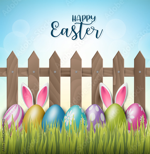Happy Easter background with realistic 3d colorful eggs, wooden fence, flowers and hiding bunny ears Wallpaper Mural
