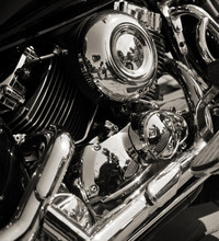 Closed Chromed Motorcycle Engine. Small Details In Reflection