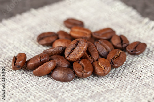 Natural roasted coffee beans on rural sackcloth