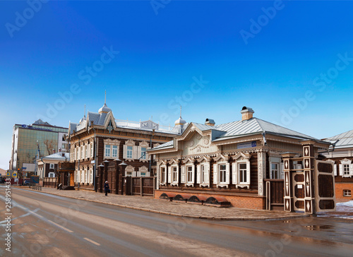 Photo  Old wooden houses decorated with traditional Russian carving on Friedrich Engels street