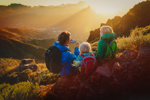 Father And Two Kids Travel In Mountains, Family Hiking