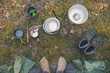 camping gear and traveler feet by the tent. top view