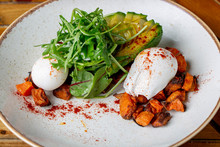 Sweet Potato Cubes Rocket Salad Wit Avocado And Pouched Eggs, Homemade And Healthy