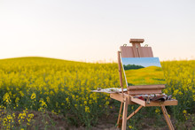 Easel With Paints And Canvas P...