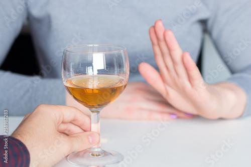 man offer alcohol but woman refuses Wallpaper Mural