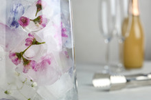 Glass Vase With Floral Ice Cubes On Table, Closeup. Space For Text
