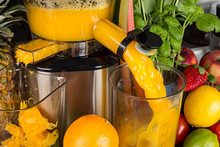 Slow Juicer In Kitchen With Many Fruit And Vegetable Orange Vitamin Juice Healthy Lifestyle Concept Background