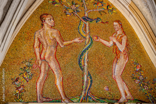 Canvas-taulu Bible scene of Genesis with Adam and Eva at major entrance portal of Saint Vitus