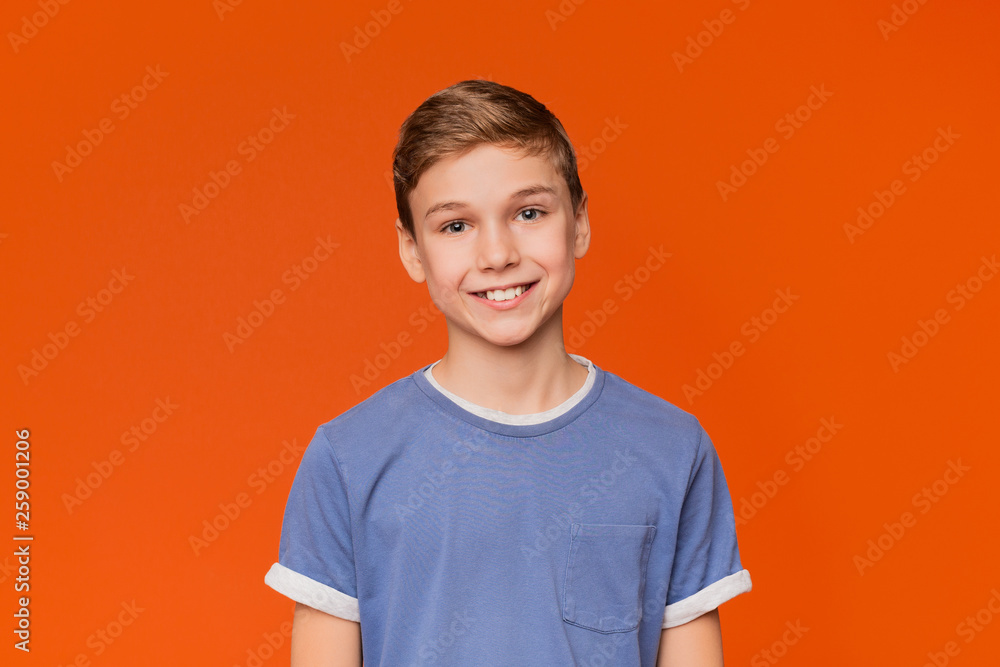 Fototapety, obrazy: Portrait of young boy on orange background