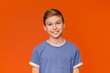 canvas print picture - Portrait of young boy on orange background