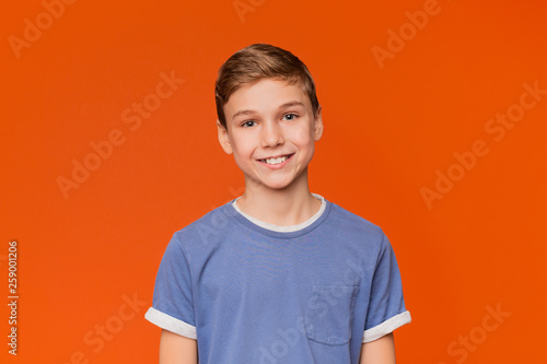 Obraz Portrait of young boy on orange background - fototapety do salonu