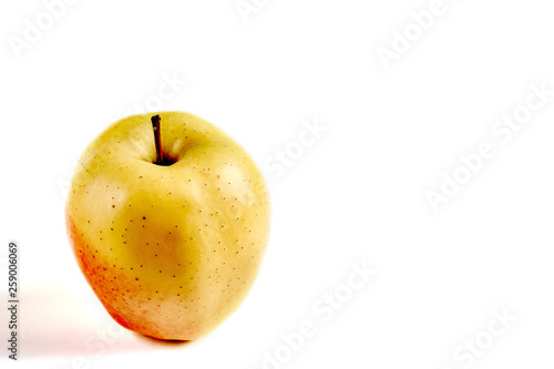 Fotografie, Obraz  Apple yellow with red side on a white background with a place for an inscription