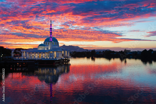 Scenic view of floating mosque on Sarawak river with colorful sunset clouds background Canvas Print