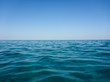 Pure nature of turquoise sea water and blue clear sky of beautiful Skala beach of Kefalonia island, Ionian sea, Greece.