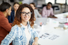 Portrait Of Contemporary Young Woman Looking At Camera While Sitting At Table During Business Meeting, Copy Space