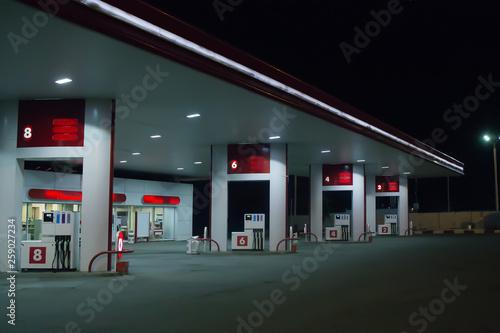 Fototapeta  Illuminated gas station at night.