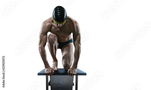 Photo Swimming pool. Isolated muscular swimmer ready to jump.