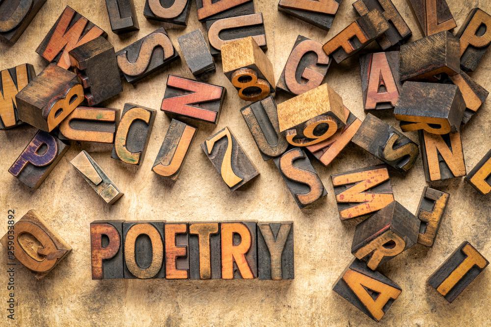 Fototapeta poetry word abstract in wood type