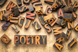 Leinwanddruck Bild - poetry word abstract in wood type