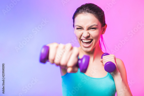 Fotografia Close-up portrait of young attractive happy woman in sport clothes with beautifu