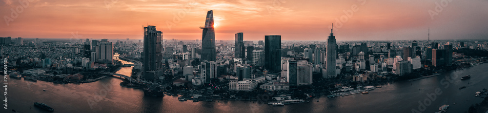 Fototapety, obrazy: Aerial drone photo - Skyline of Saigon (Ho Chi Minh City) at sunset.   Vietnam