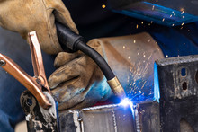 A Mig Welder Is Used To Weld Two Pieces Of Metal Steel Together Close Up