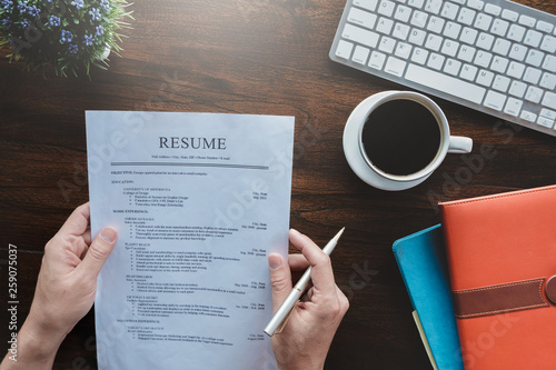 New graduate student holding resume application with pen coffee cup keyboard and notebook for applying for a job Canvas Print