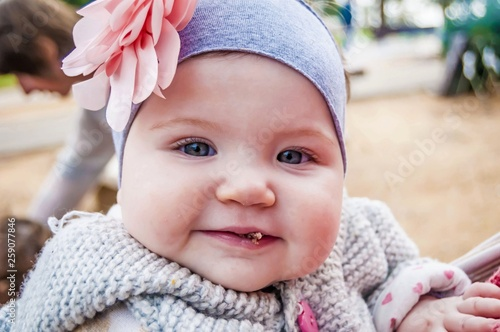 Funny, cute and adorable six or seven months old baby girl with blue