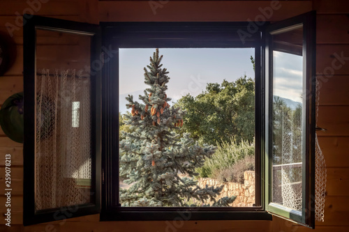 View of the mountains and the forest through the window Fototapet