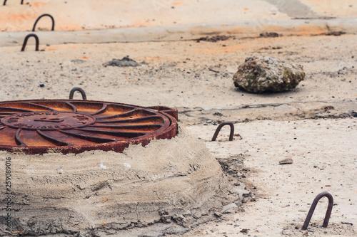 Fotografie, Obraz  Rusty manhole drain cover. Concept accident sewer