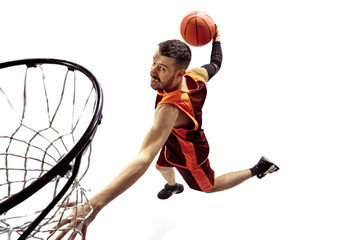 Fototapeta Sport Full length portrait of a basketball player with ball isolated on white background. Advertising concept. Fit caucasian athlete jumping at studio and throwing the ball into the basketball hoop. Motion