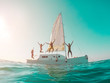 canvas print picture Happy crazy friends diving from sailing boat into the sea - Young people jumping inside ocean in summer vacation - Main focus on left girls - Travel and fun concept - Fisheye lens distortion