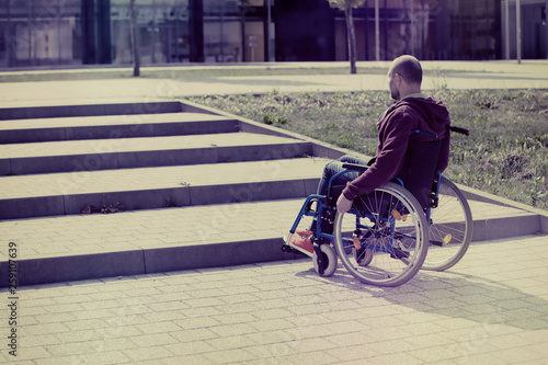 Photo  man on wheelchair and steps