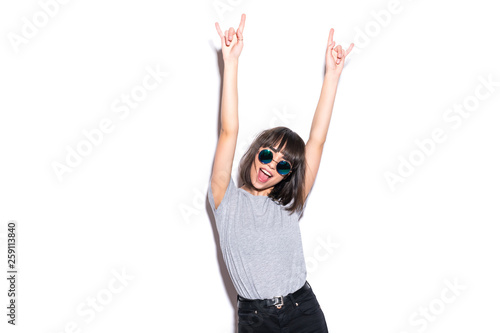 Valokuvatapetti Crazy girl in t-shirt and rock sunglasses scream holding her head Rocky woman is