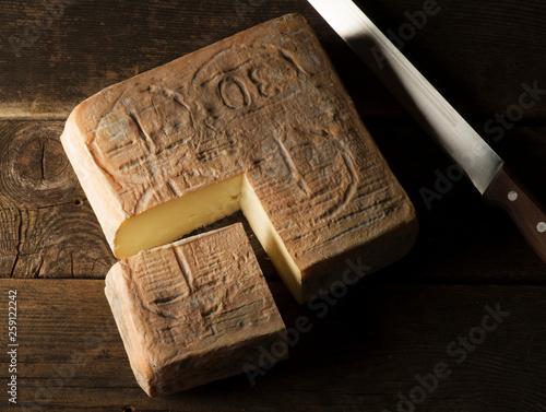 Taleggio cheese on the wooden table #259122242