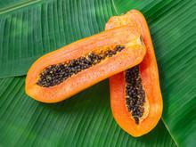 2 Halves Of Fresh Raw Exotic Tropical Thai Fruit Carica Papaya On Banana Leaves