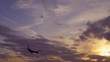 Plane flies toward sunset. The sun's rays make their way through the purple clouds. In the background, blue and orange sky. Good weather. UltraHD stock footage