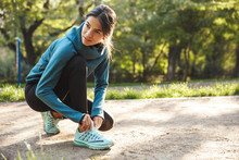 Attractive Young Fitness Woman Tying Her Shoelace