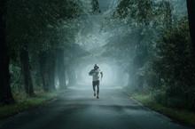 Man Running On An Empty Road O...