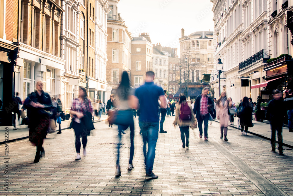 Fototapeta Motion blurred shopping street scene