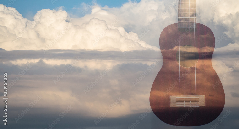 Fototapeta Double exposure with Ukulele and clouds background. Music or arts concept