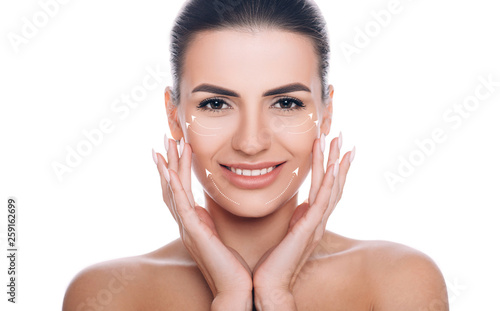 Carta da parati portrait of beautiful woman with perfect skin of the face, with arrows on face, concept of lifting skin