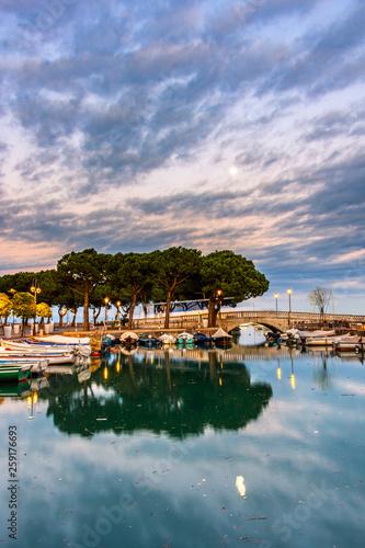 Sunset over marina at Lake Garda in Desenzano, Italy Fototapeta