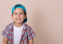 Smiling Young Boy Wearing Baseball Cap. Summer, Isolated
