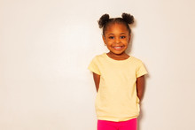 Portrait Of Nice Little Black Girl Smile Over Wall
