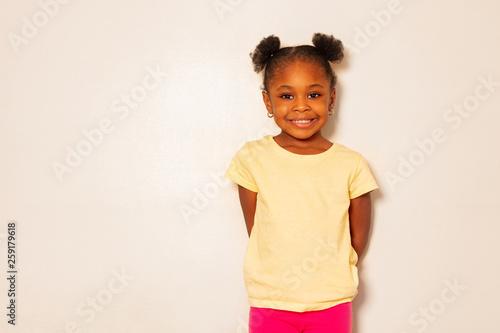 Obraz Portrait of nice little black girl smile over wall - fototapety do salonu
