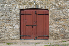 An Old Coach House Doorway Entrance With A Modern Door Fitted With Three Security Bolts